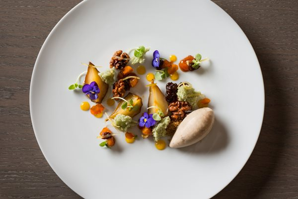 Roasted Pear with Walnuts Pansies Orange Candy Zest Citrus Marigold Petal and Micro Basil